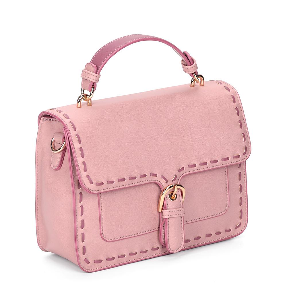 Розовая сумка с жесткой основой небольшого размера фото