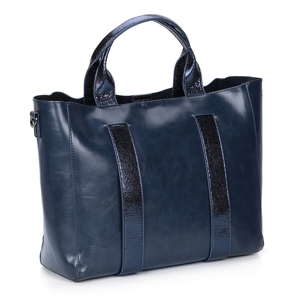 Вместительная сумка синего цвета с металлическим отливом фото