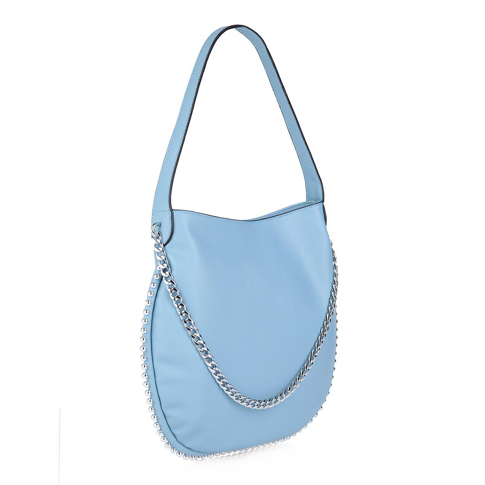 Голубая сумка с железными элементами декора фото