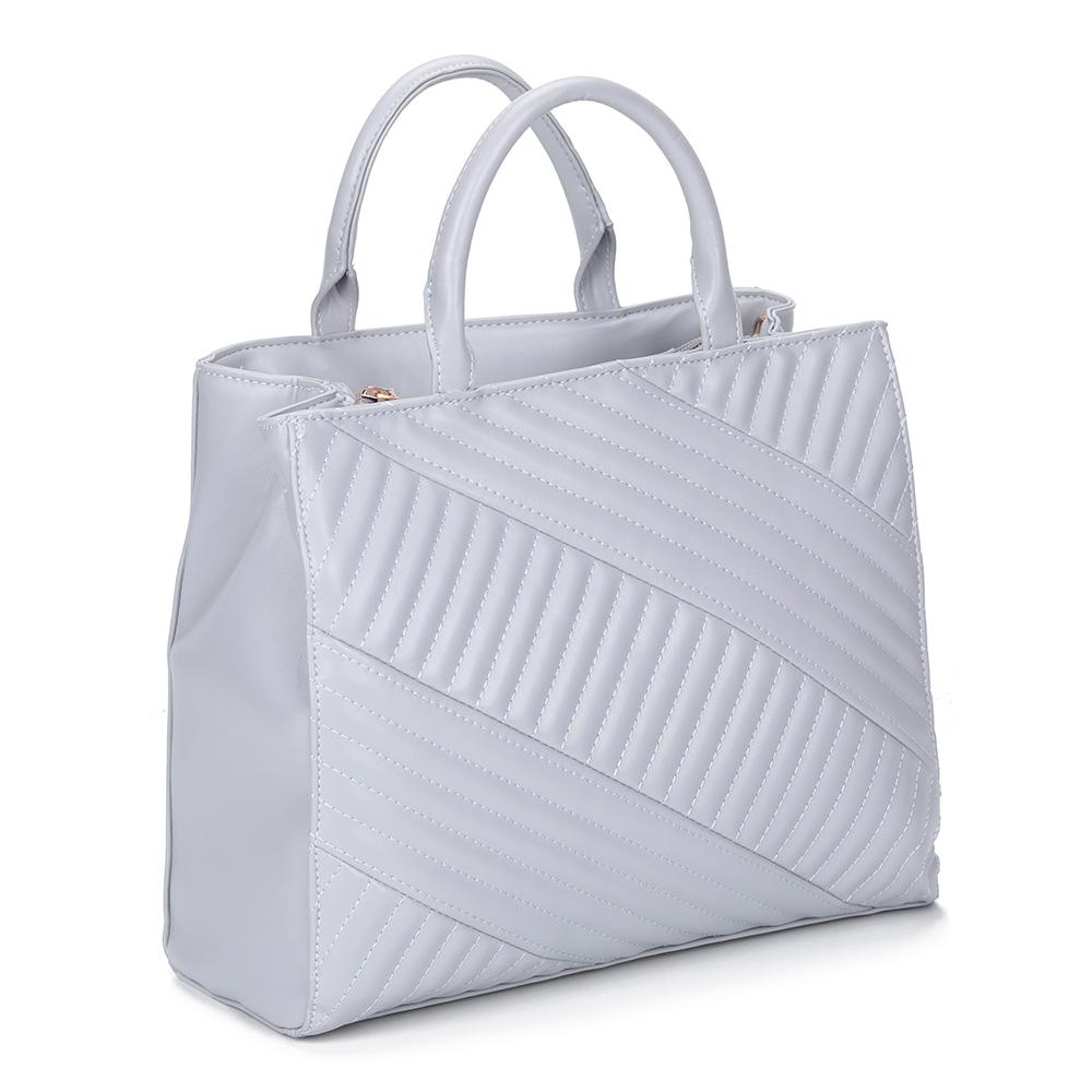 Голубая сумка с декоративной прошивкой фото