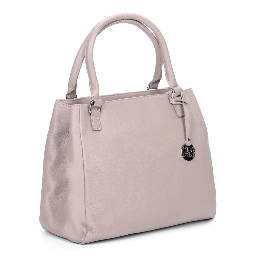Розовая кожаная сумка с брелоком фото